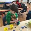 Luca making an play-doh shamrock